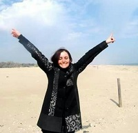 Gloria, who has an invisiabe disability, on beach