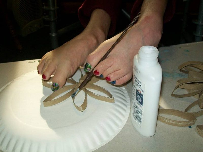 Meghan using her feet for a craft project