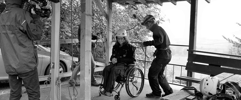 Photo of Disability and travel: wheelchair abseiling with the BBC