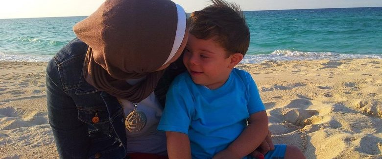 Tasneem as with his mother on a beach