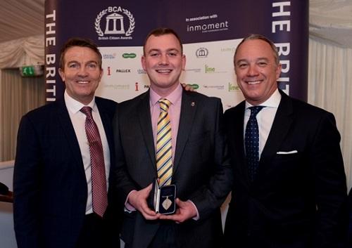 Adam Black receiving an award