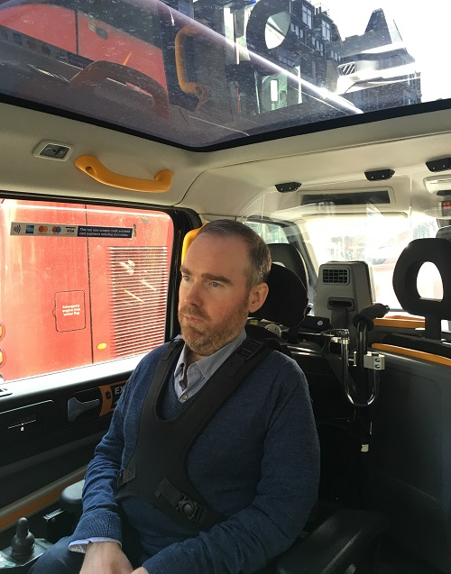 Toby Middleton in accessible black cab in his wheelchair