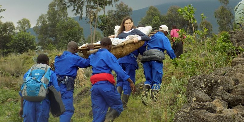 Susie being carried up to see the gorillas on a stretcher