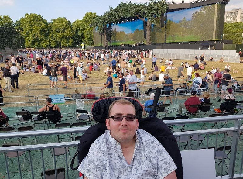 Alex Squire in wheelchair at Summer Time Ball