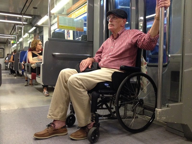 Wolf in his wheelchair on metro in Spain