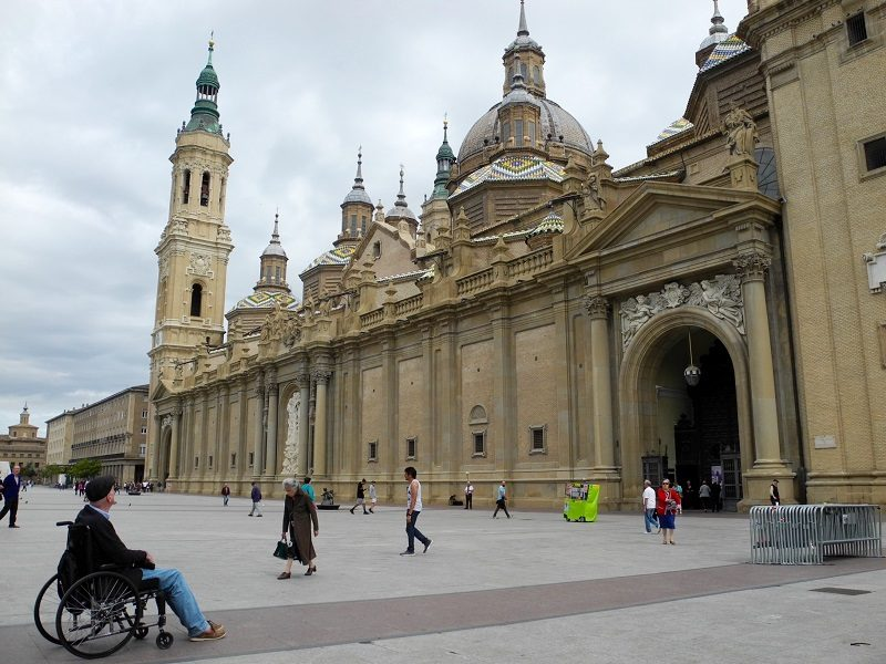 Wolf in his wheelchair outside Basilica del Pilar in Zaragoza