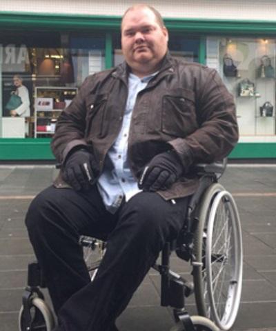 Simon Sansome in his wheelchair