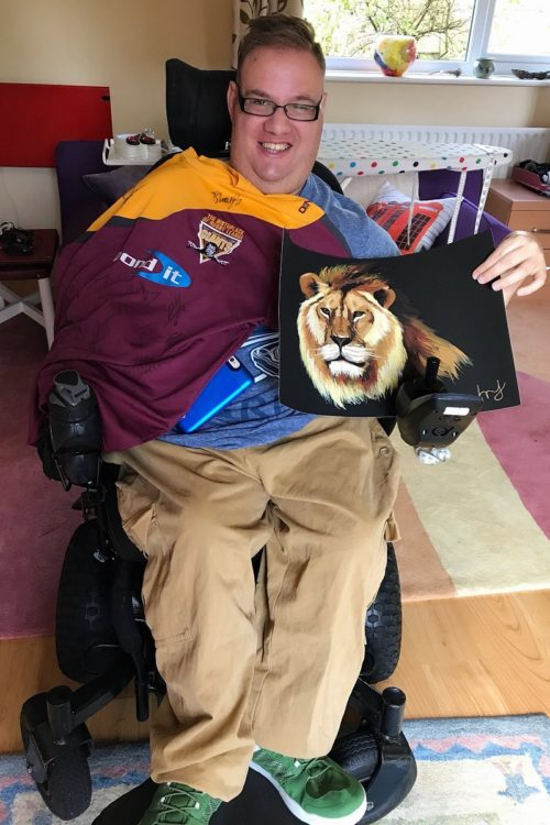 Wheelchair user Harry Newton with football shirt
