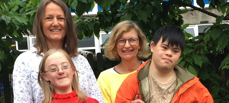 Jane Chong and Jane Kippax with their children who have Down's syndrome