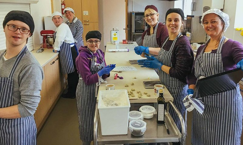 Trainee bakers with learning disabilities baking at Step and Stone