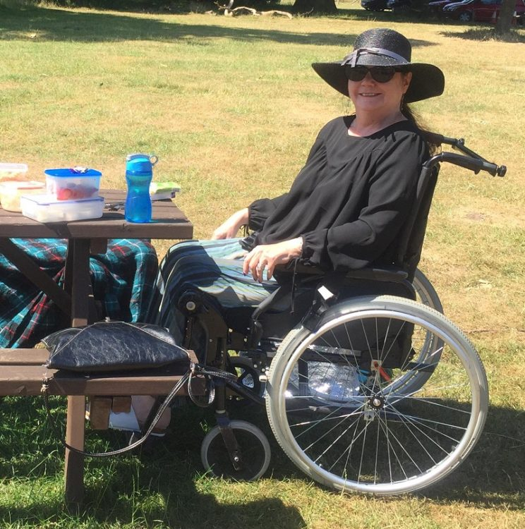 Helen Wheels in her wheelchair having a picnic
