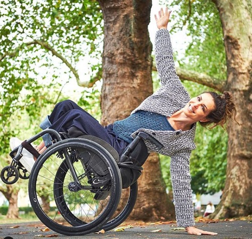 Samanta Bullock tilting her wheelchair back and balancing on her arm