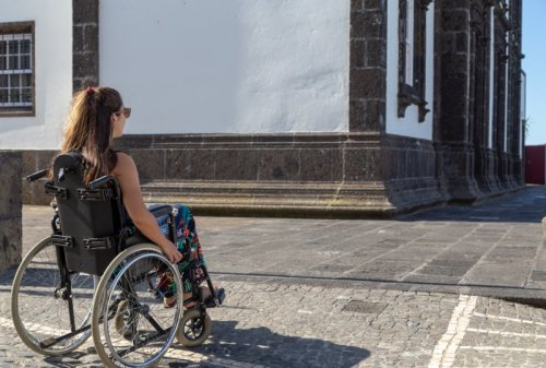 Female wheelchair user in Azores town