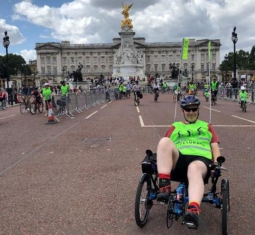 Nick outside Buckingham Palace in adapted bike