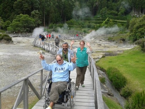 Wheelchair user coming over bridge in Azores
