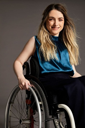 Wheelchair user in blue top