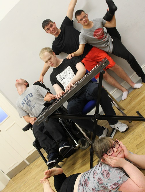 A group of disabled people making music