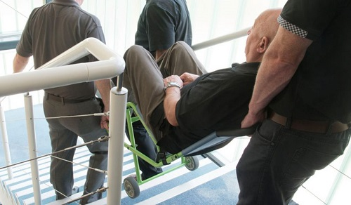 Disabled man in a transit chair