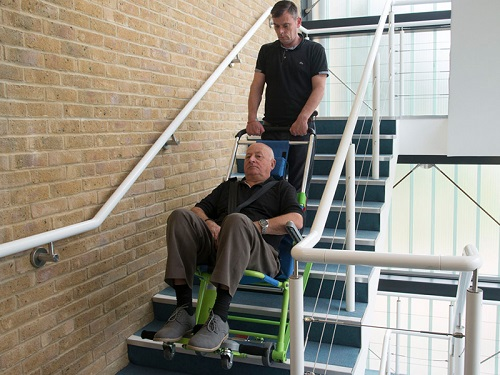 Disabled man in evacuation chair