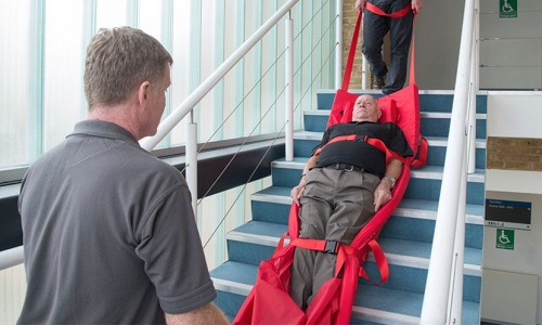 Disabled man strapped into a rescue sheet