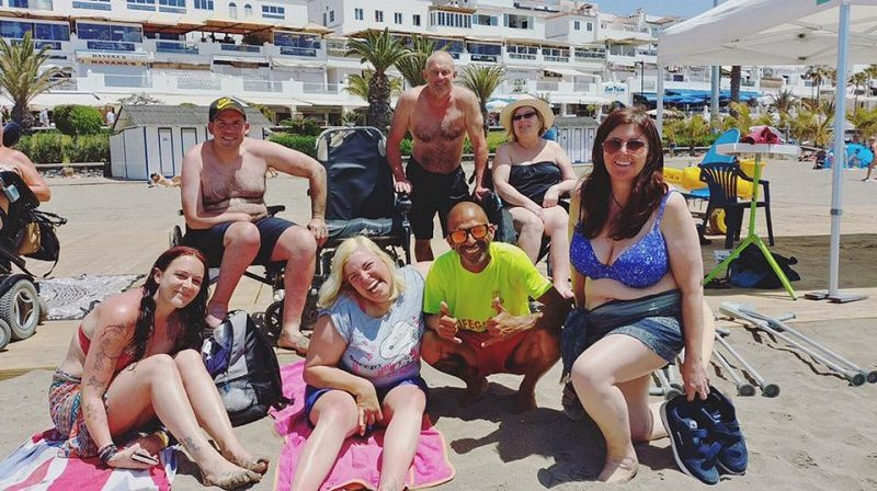 Disabled people on a beach on holiday