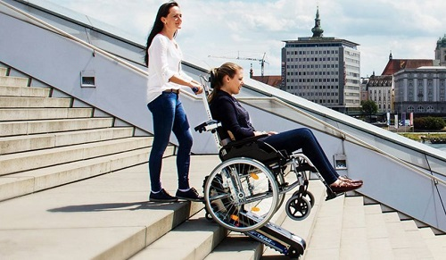 Disabled woman in a stairclimer