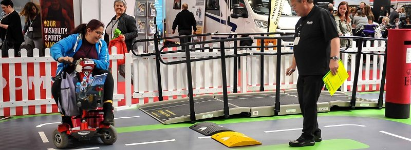 Disabled woman on mobility test track at Naidex 2019