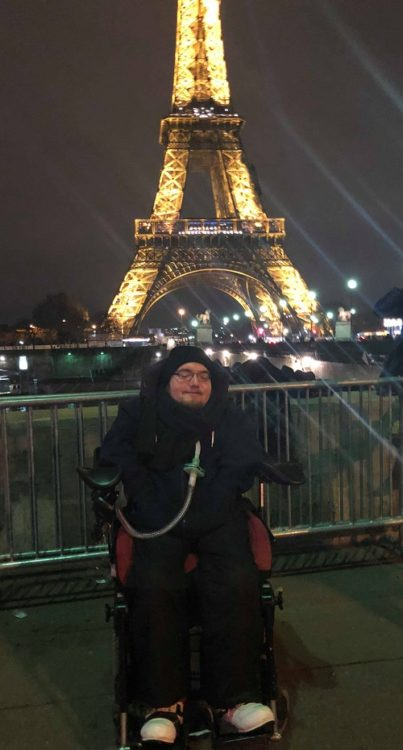 Wheelchair user Derry Felton in front of the Eiffel Tower