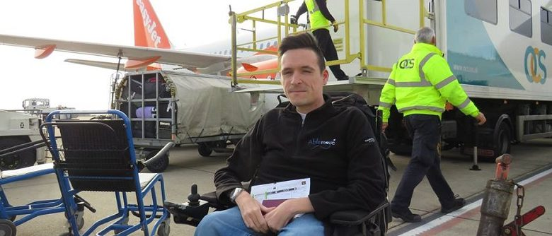 Josh in his wheelchair outside an aircraft