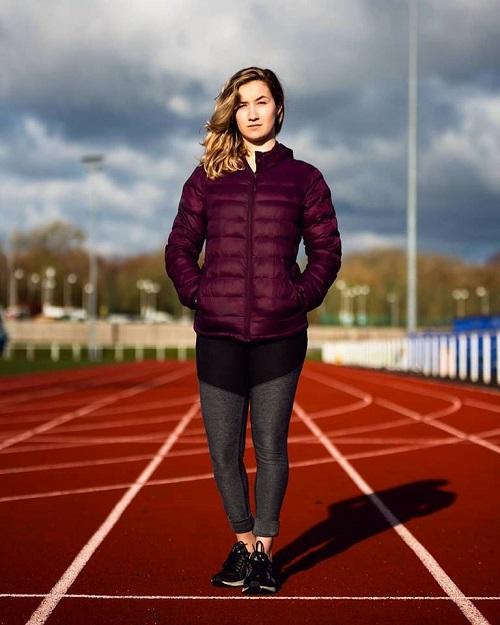 Para-athlete Victoria Baskett standing on sprinting track