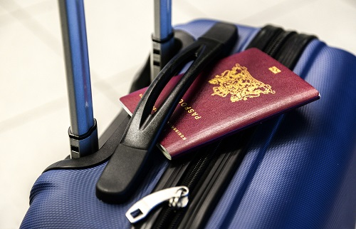 Passport on top of a suitcase