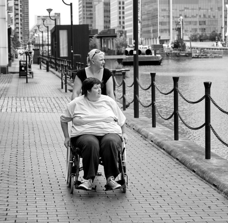Personal assistant with woman in a wheelchair