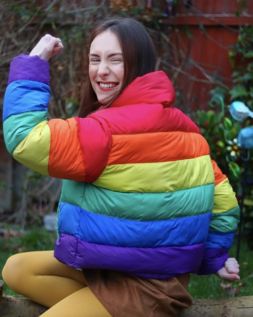 Rebecca Sullivan in a rainbow coat