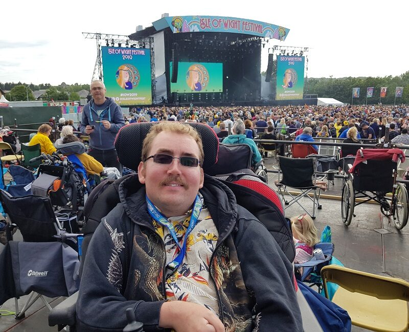 Wheelchair user Alex on a viewing platform the Isle of Wight festival