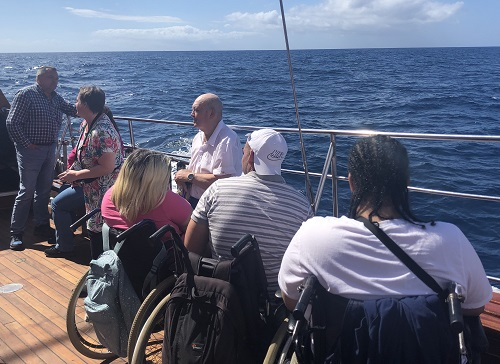 A group of disabled travellers on a boat on a disabled-friendly holiday