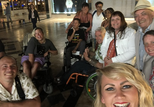 A group of disabled travellers on a disabled-friendly holiday with Limitless Travel