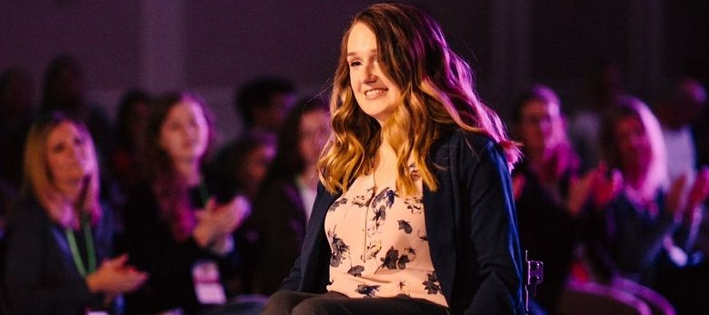 Wheelchair user Shannon modelling in a fashion show for wheelchair users