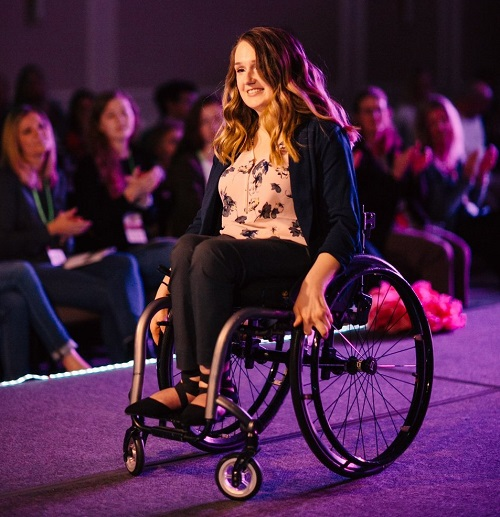 Wheelchair user Shannon modelling in an inclusive fashion show