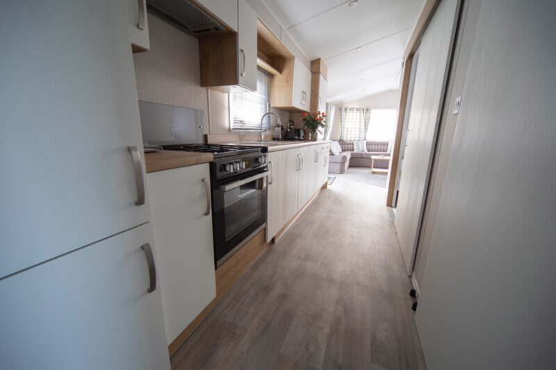 Accessible caravan kitchen with fridge, oven,, sink, toaster, kettle and cupboards