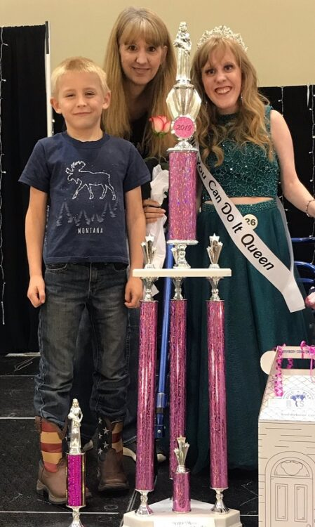Autumn Kinkade winning a pagent with her family