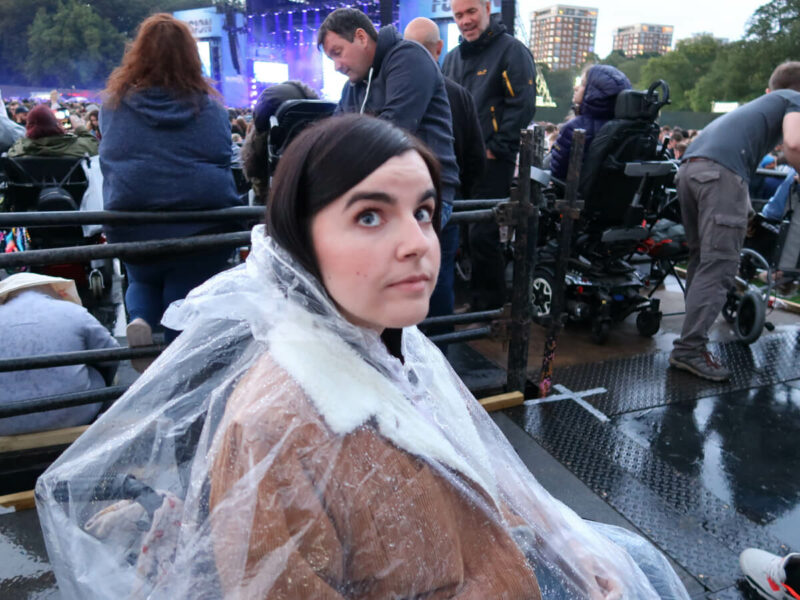 Emma wearing a poncho looking worried