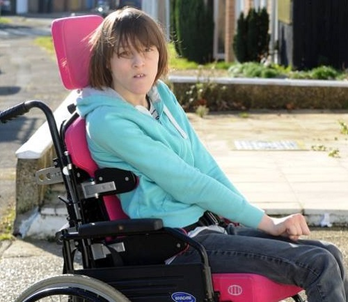 Ailsa in her pink manual wheelchair