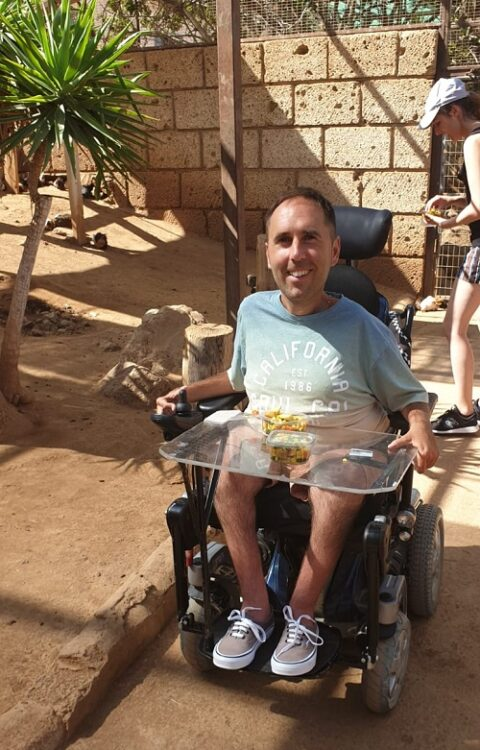 Wheelchair user Martyn Sibley at a zoo in Tenerife with Limitless Travel