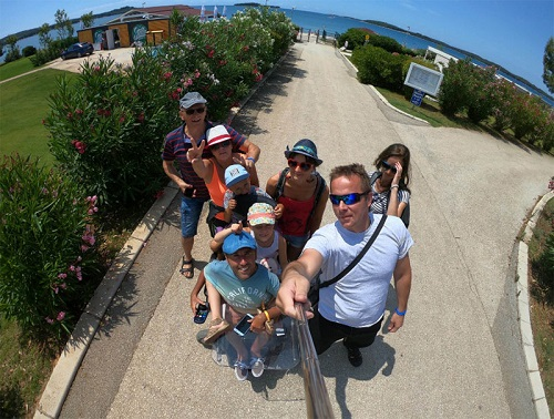 Wheelchair user Martyn Sibley with his fiance and family in Croatia near the beach