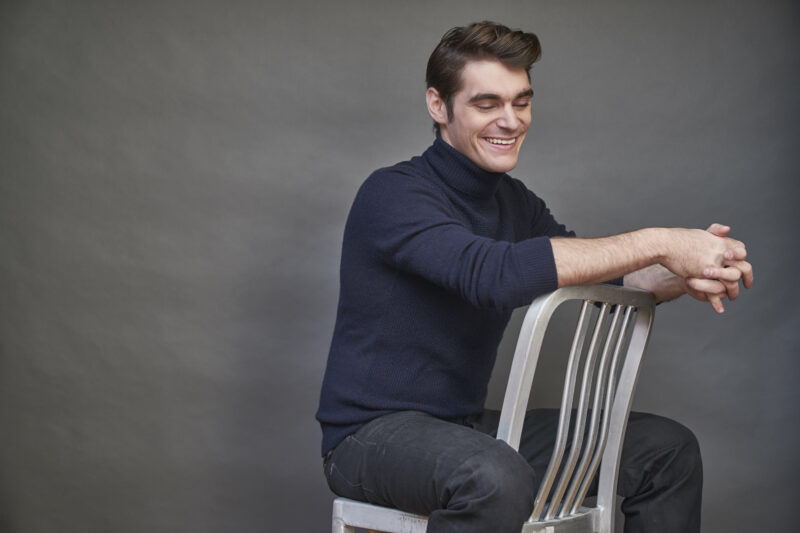RJ Mitte sat backwards on chair with eyes closed Credit: Bobby Quilland