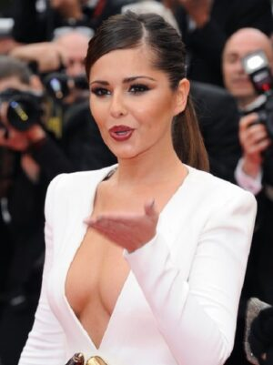 Cheryl Cole on red carpet in white dress