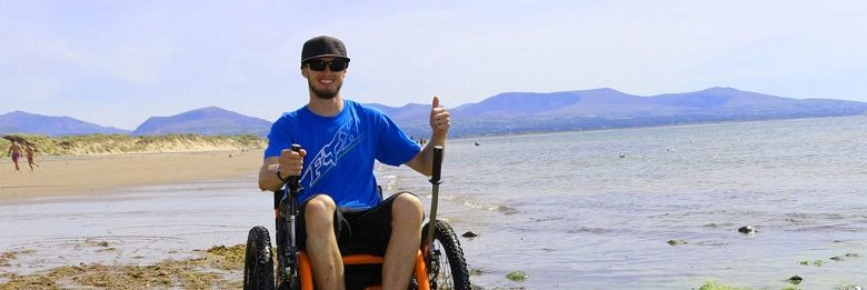 Mountain Trike all-terrain wheelchair on a beach