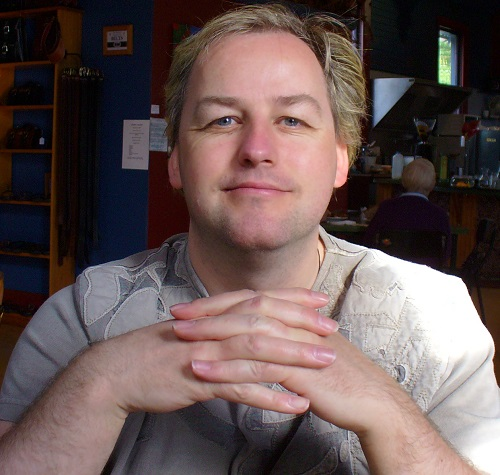 Wheelchair user Chris Goodwin, founder of SchoolMates, in a coffee shop