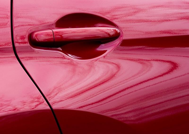 Red car door handle