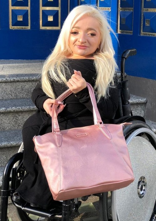 Sam Renke in her wheelchair with her accessible handbag